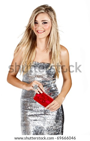beautiful smiling blond woman in silver dress holding red gift box isoltaed on white - stock photo