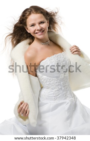 beautiful smiling bride with flying hair in a wedding dress and a fur coat, isolated on white - stock photo