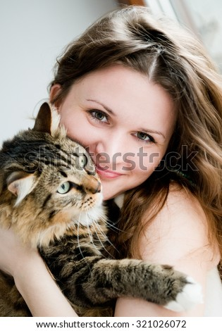 beautiful smiling brunette girl and her ginger cat  - stock photo