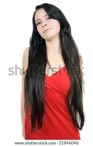 Beautiful smiling brunette with long hair dressed in red, on black background