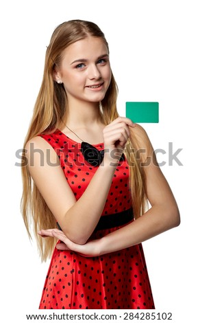 Beautiful smiling business woman and in the red, holding a card in hand, isolated on white background - stock photo