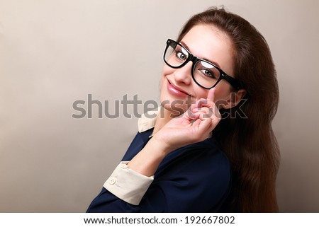 Beautiful smiling business woman in glasses looking on empty space background