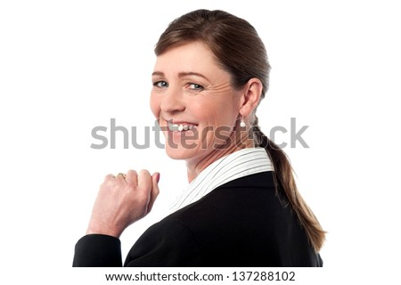 Beautiful smiling business woman  turns back and looks over.