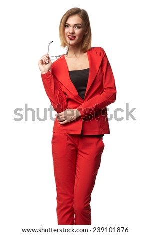 Beautiful smiling business woman wearing spectacles and in the red, holding a card in hand, isolated on a white background - stock photo