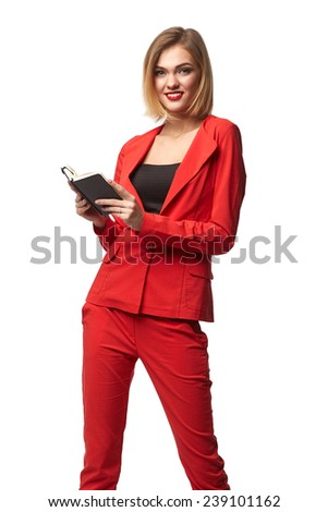 Beautiful smiling business woman wearing spectacles and in the red, with notebook, isolated on a white background - stock photo