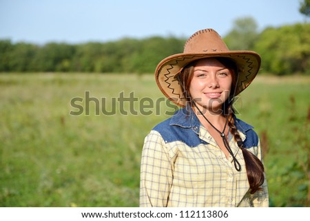 Beautiful Smiling Cowgirl  outdoor - stock photo