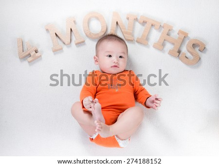 Beautiful smiling cute cheerful baby giving you hands - stock photo