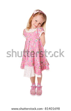 Beautiful smiling cute little girl in pink dress isolated on white background - stock photo