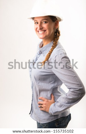Beautiful smiling engineer girl - stock photo
