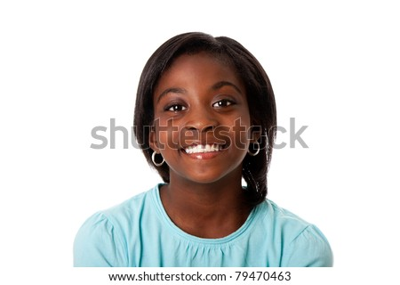 Beautiful smiling face of a happy African teenager girl, isolated. - stock photo