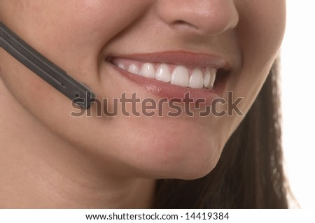 Beautiful smiling female hotline operator with headset - stock photo