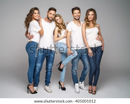 Beautiful smiling friends in fashionable jeans