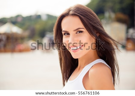 Beautiful smiling girl enjoying  warm summer weather