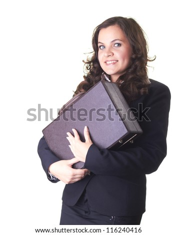 beautiful smiling girl in a black business suit, isolated on a white background hugging brown briefcase with two hands