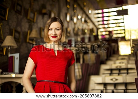 Beautiful smiling girl in red dress - stock photo