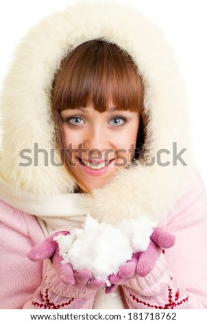 Beautiful smiling girl in warm clothes with snow - stock photo