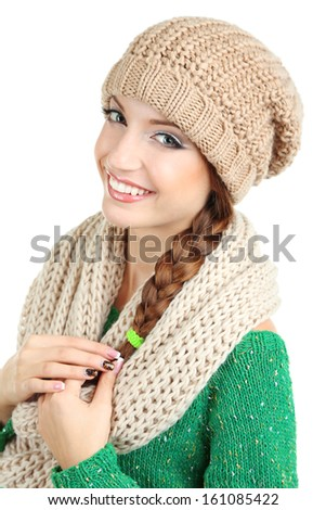 Beautiful smiling girl in warm knit scarf and hat isolated on white - stock photo