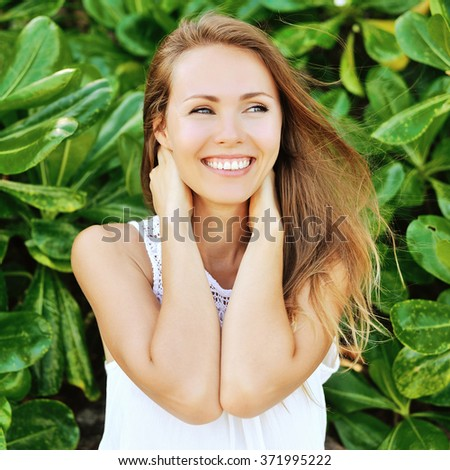 Beautiful smiling girl outdoor portrait - stock photo
