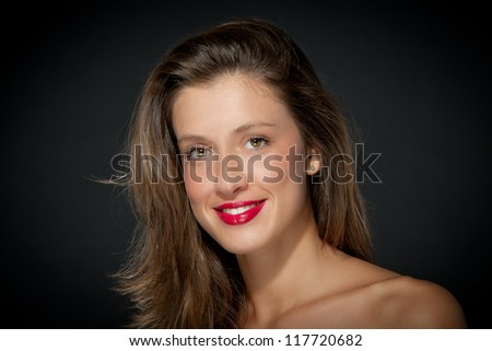 beautiful smiling girl over grey background