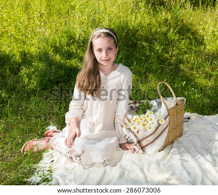 Beautiful smiling girl resting in the park - stock photo