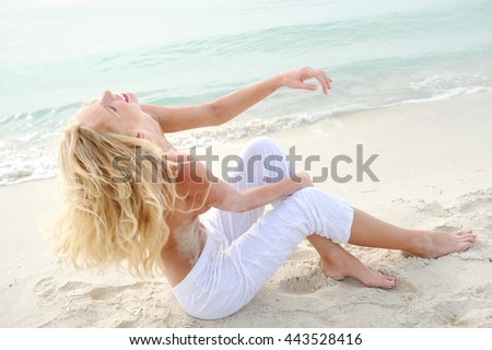 beautiful smiling girl taking sun on the beach