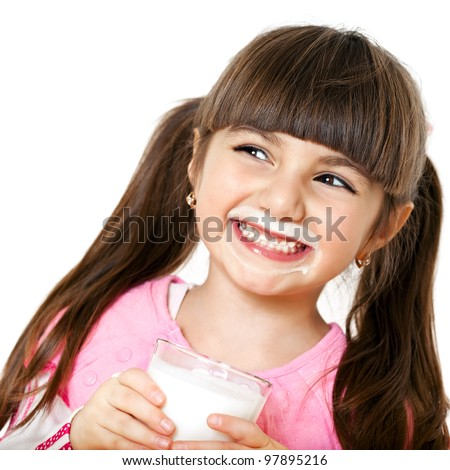 beautiful smiling girl with a glass of milk - stock photo