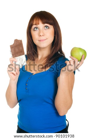 Beautiful smiling girl with apple and chocolate on white background - stock photo