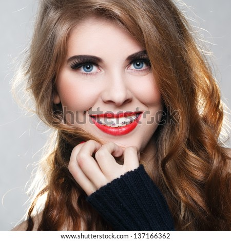 Beautiful smiling girl with braces - stock photo