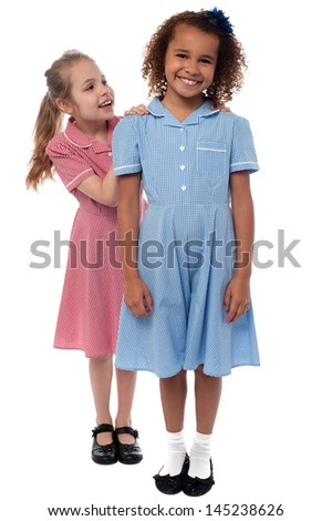 Beautiful smiling girls in school uniform - stock photo