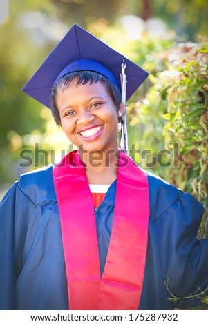 beautiful smiling graduate smiling - stock photo