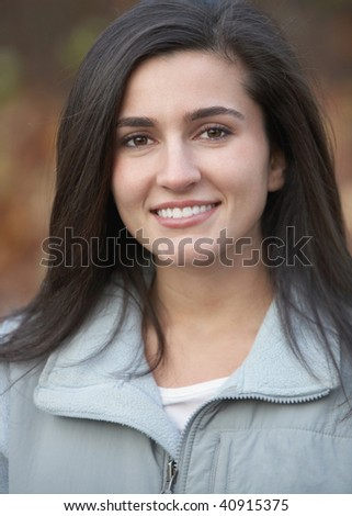 Beautiful smiling healthy young woman outdoor nature portrait