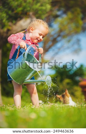 Beautiful smiling little girl helping in the spring work, gardening