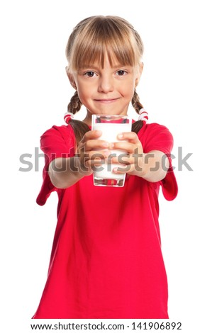 Beautiful smiling little girl with a glass of milk isolated on white background - stock photo