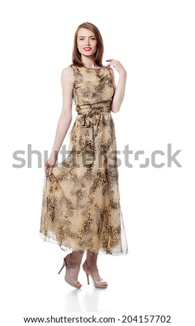 Beautiful smiling model posing in cocktail dress - stock photo