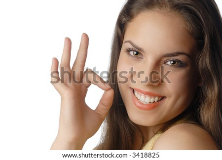 Beautiful smiling model with OK gesture with well-conditioned skin and teeth