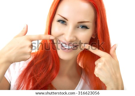 Beautiful Smiling Redhead Girl showing Retainer, Braces for Teeth. Orthodontics Dental Theme, Methods of Teeth (Bite) Correction, Close-up - stock photo