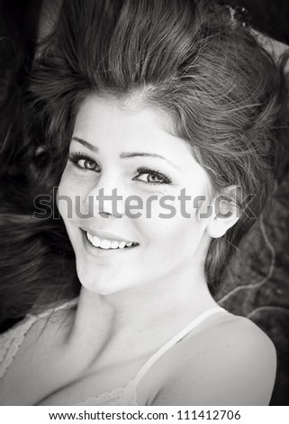 Beautiful smiling teen girl in black and white - stock photo