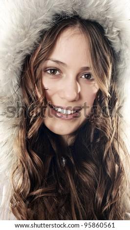 Beautiful smiling winter coat girl - stock photo