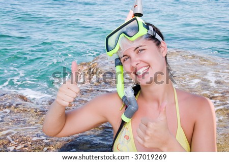 Beautiful smiling woman at the beach