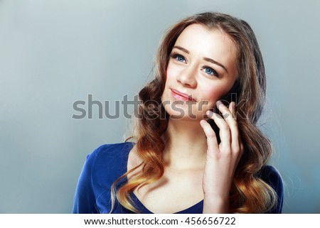 Beautiful smiling woman calling by phone - stock photo