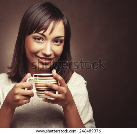 Beautiful smiling woman drinking coffee - stock photo
