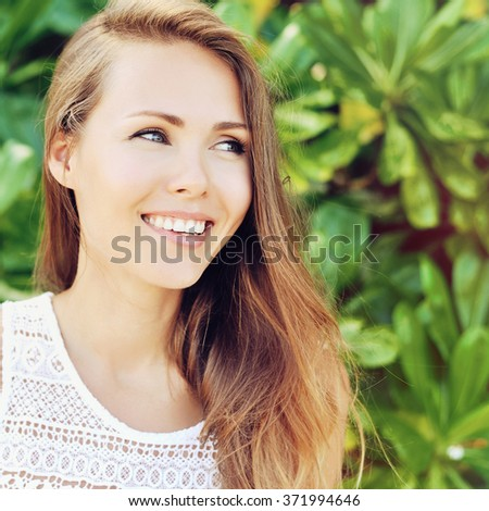 Beautiful smiling woman face - stock photo