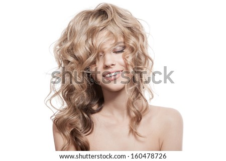 Beautiful Smiling Woman. Healthy Long Curly Hair - stock photo