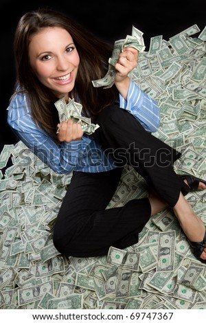 Beautiful smiling woman holding money - stock photo