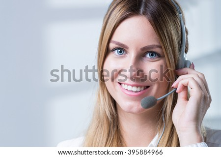 Beautiful smiling woman in corporation talking with client - stock photo