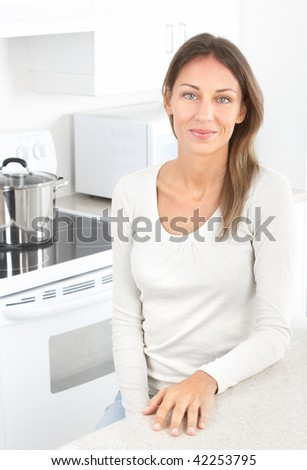 Beautiful smiling woman in kitchen