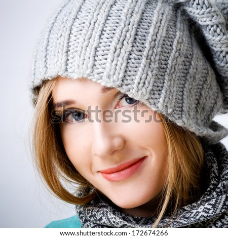 Beautiful smiling woman in winter hat