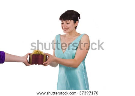 Beautiful smiling woman is getting the gift.  Girl in greenness of the sea dress is standing and holding purple box with gold ribbon on white background.