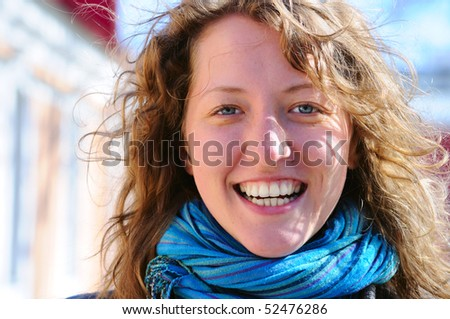 beautiful smiling woman is looking at camera