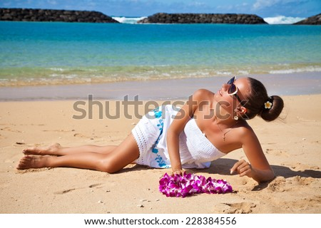 Beautiful smiling woman on beach on the Hawaiian Honolulu island. Holiday resort vacation. - stock photo